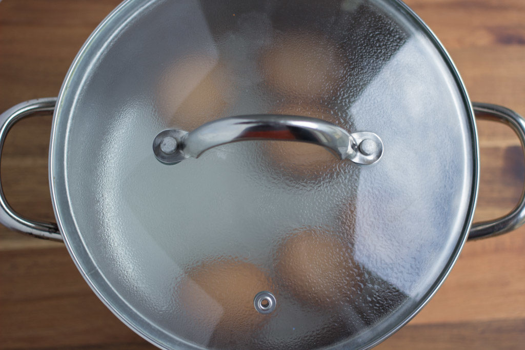 Lid is placed on steaming pot of eggs.