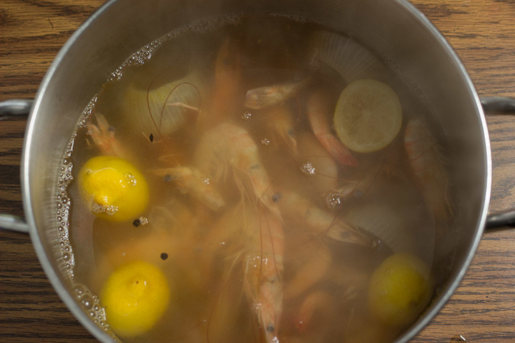 Shrimp boiling in seasoned water.