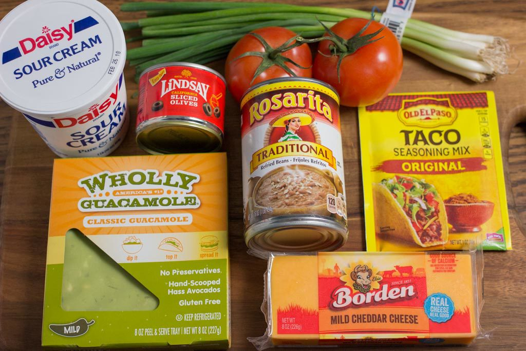 Individual ingredients for 7 Layer Bean Dip.