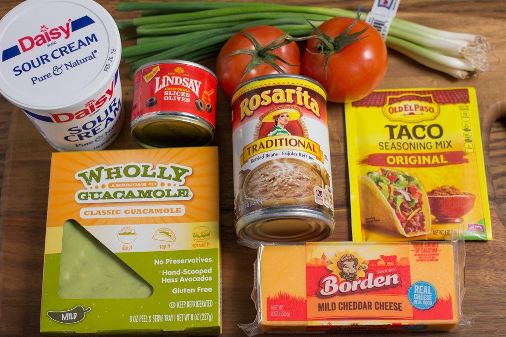 Individual ingredients for 7 Layer Bean Dip.