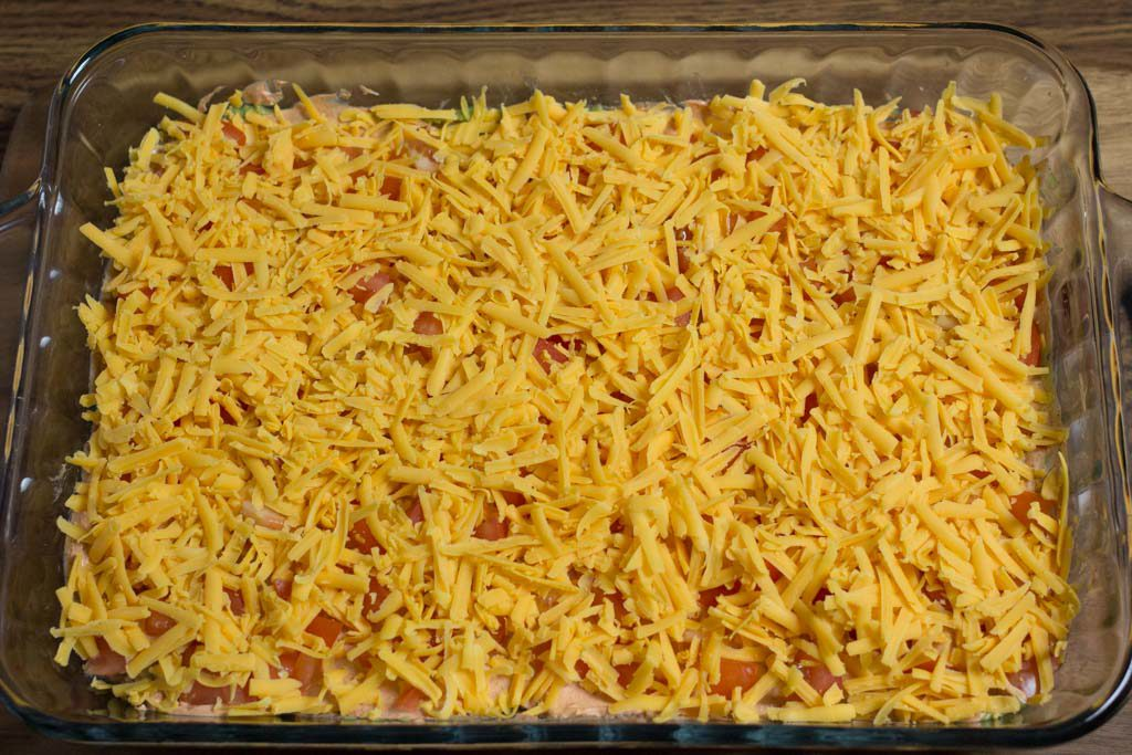 Cheese sprinkled onto the dip.