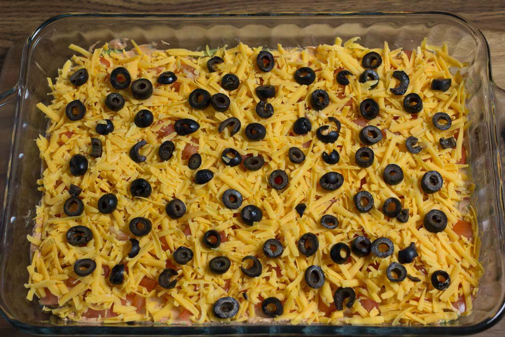 Black olives sprinkled onto the dip.